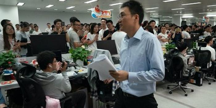 Huang Zheng at Pinduoduo with his colleagues