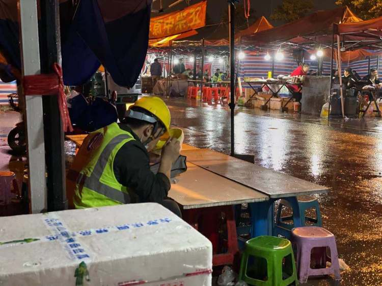 A Tesla worker finishing his meal at the street food stalls outside the Shanghai Gigafactory 3.